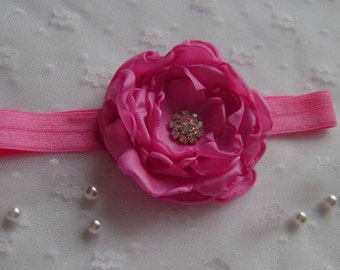 A Bright Pink Headband with Rhinestone centre