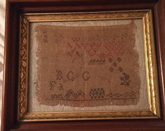 Antique framed sampler