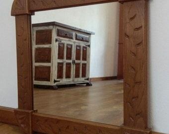 Framed carved wood mirror