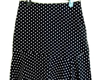 Pale with pink dots black knee length skirt. Vintage.