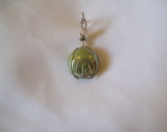 Wire wrapped green glass cabochon with pealized shine pendent