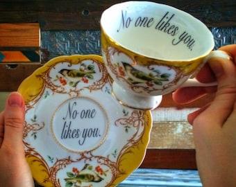Insult bird teacup and saucer