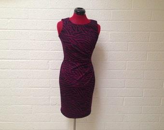 Calvin Klein Size 2 comfortable jersey knit purple and black zebra print