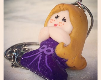 Doll in polymer clay pendant