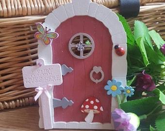 Fairy door with beautiful embellishments