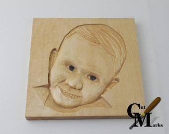 Hand carved family portraits