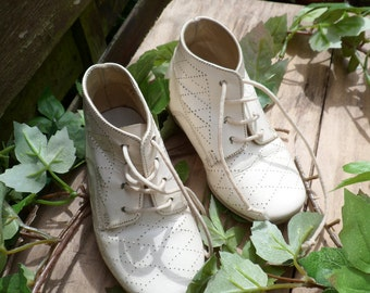 Old small of child yellowed by time, old boot, shoe baby patent leather shoe