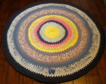Hand-made, Knotted-style round rug, using recycled cotton fabric. Sometimes called rag rug. Price reduced by 1/3. Ship to USA address 25.00