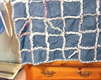 baby blanket with denim on one side and colorful squares on the other