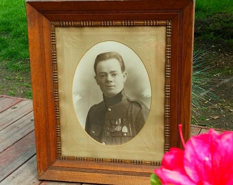 Wooden frame and WWI military photography