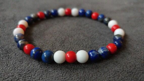 Freedom. Red Turquoise, White Matte Quartz, Lapis Lazuli on stretchy string.