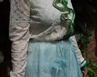 white lace blouse with green details.