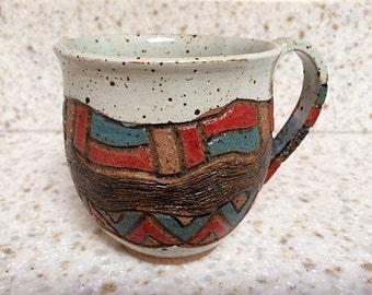 Handmade stoneware pottery mug with hand-carved geometric designs, Aztec-inspired rustic ceramic mug