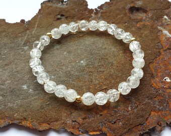 Rock crystal bracelet with gold items made from 925 Silver