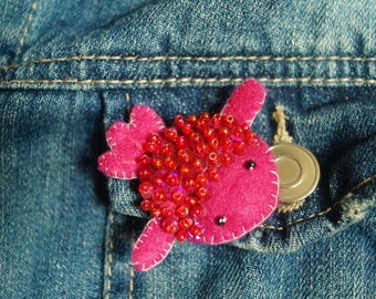 Pink goldfish brooch decorated with glass beads