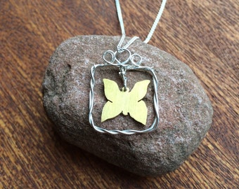 Silver necklace with a butterfly in a frame