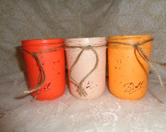 Painted Mason Jars in three shades of orange for that Rustic look.