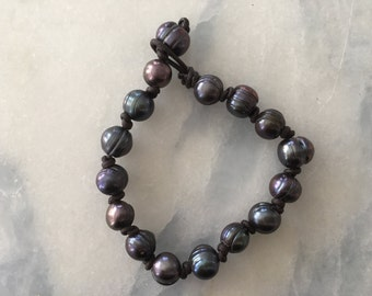 Pearl and leather handknotted bracelet