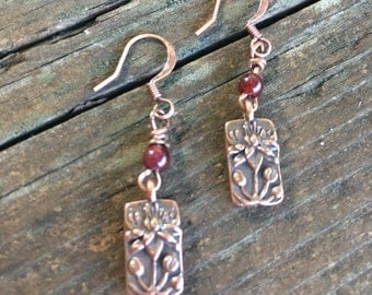 Floating Berry Lotus - copper lotus flower earrings with a garnet accent bead.