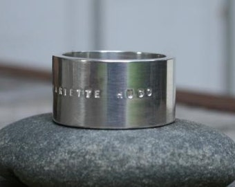 Wide silver ring Words