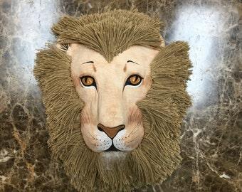 Three dimensional paper mache lion mask.