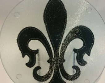 Fleur-de-lis glass cutting board, trivet, hot plate.