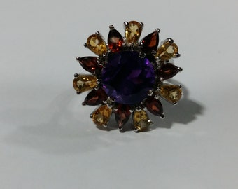 Round amethyst, citrine and garnet ring mounted in sterling silver