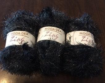 3 skein Moda Dea glittery black eyelash yarn.
