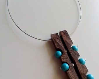 Necklace in wood and precious stones