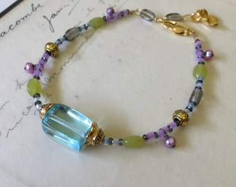 I'm Listening. Beaded bracelet Blue Quartz, glass, Pearl and Jade