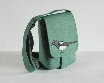 Small linen messenger bag with magpie