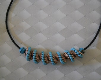Cellini Spiral Necklace on Braided Leather: Turquoise, Salmon, Bronze, Teal, Cream; Sterling Clasp