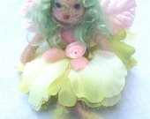 Forest Whimsy needle felted flower fairy doll with green hair, green flower petal skirt and  pink velvet leaf wings