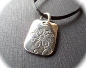 Daisy Pendant in Sterling on a Satin  Cord
