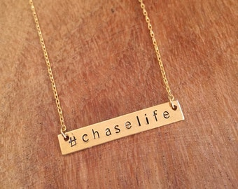 Gold bar necklace with heart