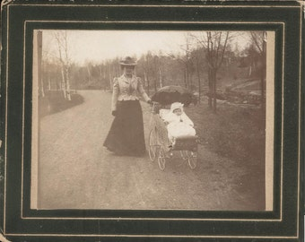 vintage photo Cabinet Mother Walking Baby in Wicker buggy down Road