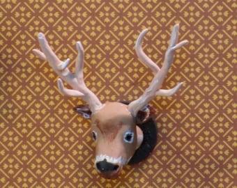 Miniature deer head wall mount trophy