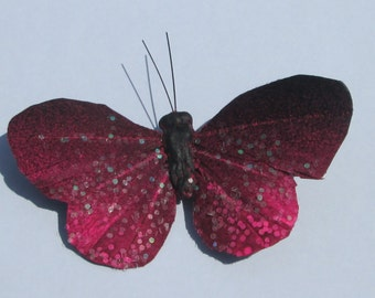 When MIDNIGHT is PINK customized black feather butterfly with neon pink design and iredescent glitter hand made hair clip