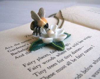 Bumble Bee charm necklace - ceramic bee and flower in yellow white and green on brass - spring time - large