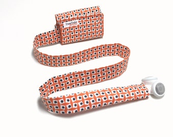 Orange with dots and squares TuneTube.  Earbud cord organizer for iPhone or iPod.  Cord keeper.  Earbud holder.  Earbud case.