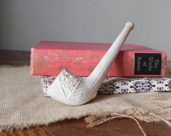 Vintage ceramic white pipe with medical symbol