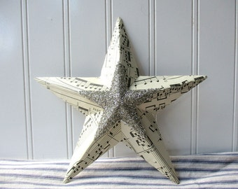 Vintage sheet music metal star silver German glass glitter star center collaged mixed media 8 inch wall hanging