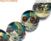 ON SALE 30% OFF Seven Teal Treasure Ii Lentil Beads -10410402-Handmade Lampwork Glass