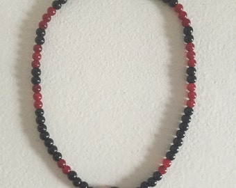 Red and black beaded necklace.