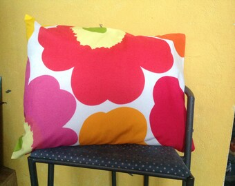 A PAIR. Unikko pillowcases in Vibrant red.