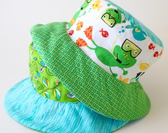 Reversible toddler sun hat, bucket hat, first birthday gift with swimming frogs