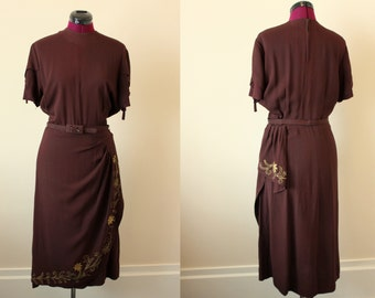 1940s brown crepe dress with gold floral applique and cording on sarong skirt MED