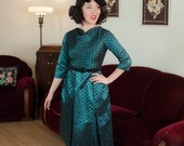 Vintage 1950s Dress - Glowing Turquoise Blue Brocade Cocktail Dress with Boatneck, Three Quarter Sleeves and Pleated Skirt