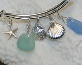 Adjustable silver bracelet with sterling silver sand dollar, seashell charm, starfish charm and aqua, blue cornflower genuine sea glass