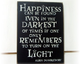 Happiness can be found even in the darkest of times if one only remembers to turn on the light wood sign
